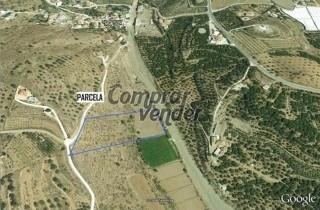 terreno en benamocarra, cruce de cajiz cerca del pueblo de los puestas